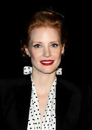 Jessica Chastain opted for a bright red lip for the Yves Saint Laurent fashion show.