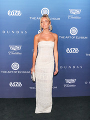 Kristin Cavallari matched her dress with a white hard-case clutch by Judith Lieber.