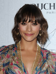 These delicate dangle earrings paired well with Rashida's gold chain necklaces.
