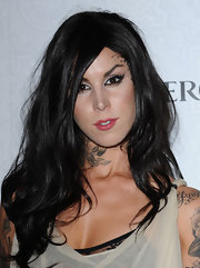 Kat Von D shows off some ink - this one is a flower with leaves on her neck.