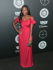 Aja Naomi King brought a dazzling pop of color to the Art of Elysium Heaven Gala with this ruby-red cold-shoulder gown by Shoshanna.