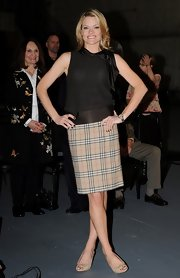 Missi Pyle went classic in a plaid skirt with a brown satin waistband.