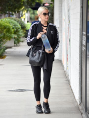 Ashlee Simpson teamed a black Adidas track jacket with leggings for a workout-ready look while out in LA.