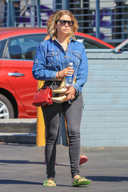 Ashley Benson bundled up in a blue denim jacket for a day out in Los Angeles.