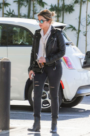 Ashley Benson was spotted out looking like a rock star in a black leather biker jacket.
