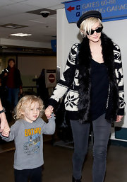 Ashlee Simpson Wentz looked ready for the holidays in a black-and-white Fair Isle sweater with faux fur trim.