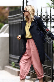 Ashley Olsen left her West Village apartment in New York City wearing a pair of pink khaki harem pants with a rolled up cuff.