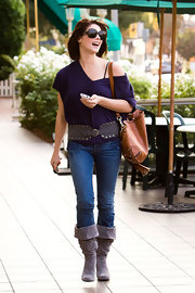 Ashley accessorized her daytime look with a wide studded belt and mid-calf suede boots.
