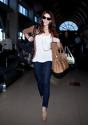 Ashley Greene was effortlessly chic in a loose white T-shirt and an open face cardigan at LAX.