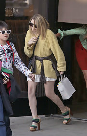 Ashley wore a multi-colored pair of wooden-soled platforms that were a combination of canvas, ostrich and leather.