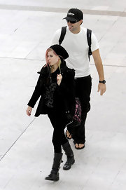 Avril wears a slouchy black beanie for her trip to the airport with Brody.
