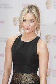 Laura chose a slightly messy updo for her effortlessly chic look at the BAFTA TV Awards.