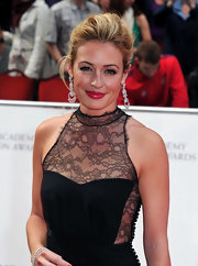 Cat Deeley looked lovely on the red carpet at the BAFTA Awards. She paired her Dior dress with a tomato red lip.