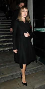 Amanda Holden left the Palladium in a sophisticated black coat dress after a round of auditions for 'Britain's Got Talent.'