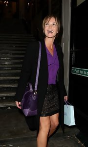 Amanda Holden left the Palladium in a sassy black lace miniskirt.