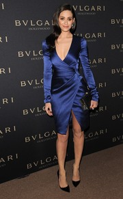 Emmy Rossum was a stunner in a low-cut blue faux-wrap dress by J. Mendel during the Decades of Glamour Oscar party.