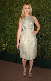 Elisabeth Rohm completed her chic outfit with a pair of strappy black platform sandals.