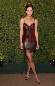 Erin Wasson oozed major sex appeal in a tight-fitting burgundy and gray mini dress during the Decades of Glamour Oscar party.