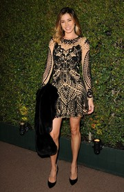 Aida Yespica chose a black and nude cocktail dress with elaborate beading and embroidery for the Decades of Glamour Oscar party.
