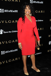 Niecy was a vision in red at the Bvlgari party. Her gold accessories made this ensemble simply divine.