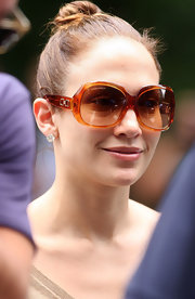 "Jennifer wears her ""Havana"" sunglasses during filming."