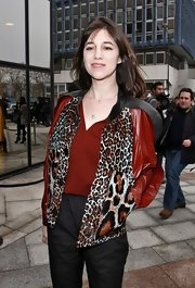 Charlotte arrived at the Balenciaga 2012-2013 Fall-Winter fashion show in this striking animal-print panel leather jacket.