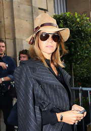 Carine Roitfeld added a playful touch to her look with a floppy bucket hat.