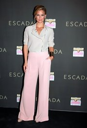 Bar Refaeli looked sweetly sophisticated at the Escada fragrance promotion in a pair of blush wide leg trousers.