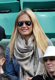 Bar Refaeli donned a Louis Vuitton silver scarf with aviator shades while watching the French Open.