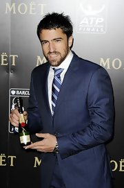 Janko Tipsarevic accessorized his blue suit with a striking blue striped tie at the Barclays ATP World Tour Finals Gala.