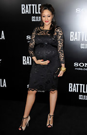 A pregnant Tia Mowry donned nude T-strap peep toes with black patent trim to the 'Battle: Los Angeles' premiere.