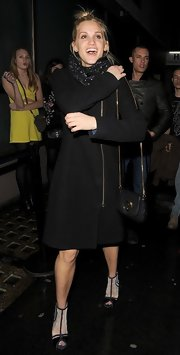 Ashley Roberts bundled up in a knee-length wool coat that gave her a sleek and modern look while out in London.