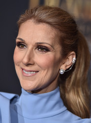 Celine Dion pulled her hair back into a classic ponytail for the premiere of 'Beauty and the Beast.'