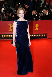Holliday Grainger teamed her velvet dress with a leather clutch at the Berlin movie premiere.