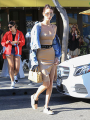 Bella Hadid kept her feet comfy in nude and black slip-on leather sneakers by Sol Sana.