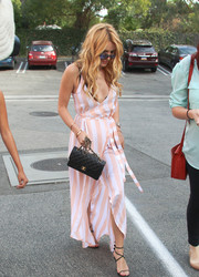 Bella Thorne turned heads in a low-cut striped wrap dress by Wildfox while out and about.
