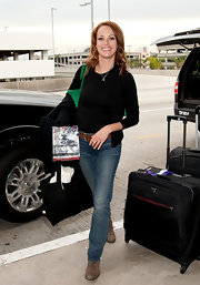 Berenice Bejo was all smiles at LAX in relaxed bootcut jeans and distressed brown leather boots.