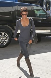 Brown knee-high boots were the perfect footwear for Halle Berry's travels.