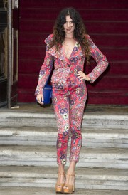 Eliza Doolittle amped up the retro feel with a pair of nude T-strap platform sandals.