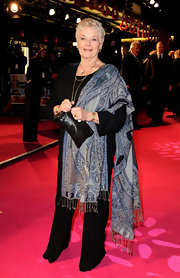 Judi Dench shows us that a casually draped pashmina can up the drama of a simple sweater and slacks outfit.