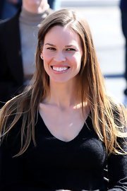 Hilary Swank visited an animal shelter wearing her long locks straight.