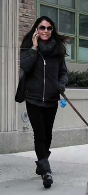Bethenny Frankel paired a black zip-up vest with a gray wool sweater for a cozy and warm ensemble.