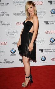 Mena Suvari melded sexy with elegant in this pleated chiffon dress at the Beverly Hills Hotel soiree.