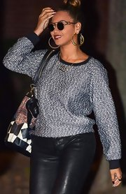 Beyonce wore this textured slouchy sweater with leather leggings for a cool combo.