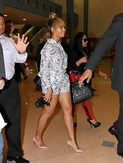 Beyonce slipped on a pair of nude Christian Louboutin pumps for a day of gallery-hopping in Miami.