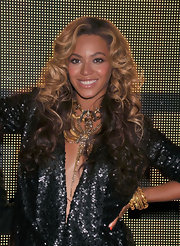 Beyonce wore a statement-making silver and gold necklace along with plenty of gold bangle bracelets at the release of her fashion collaboration with House of Dereon.