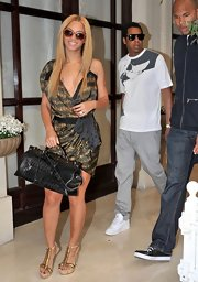Beyonce looked fierce out with Jay-Z in a silk abstract print cocktail dress.
