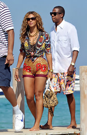 Jay Z paired his cool printed shorts with a white button down shirt.