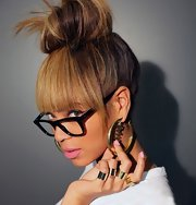 The secret to Beyonce's top-knot? We'll tell you—a few spritzes of hairspray and a whole lot of attitude.