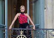 Beyonce wears a sheer evening gown with a magenta petal bodice for her 'Bazaar' photo shoot.